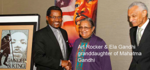 Art Rocker is standing with Rev. C.T. Vivian (a Civil Rights legend standing to the right) Ehli Ghandi in Atlanta, Georgia