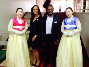 Art and Jessica Rocker standing with representatives in traditional Korean attire